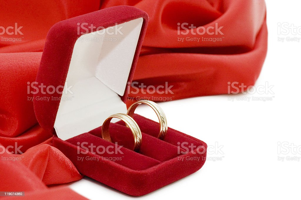 Red box with two gold wedding rings royalty-free stock photo