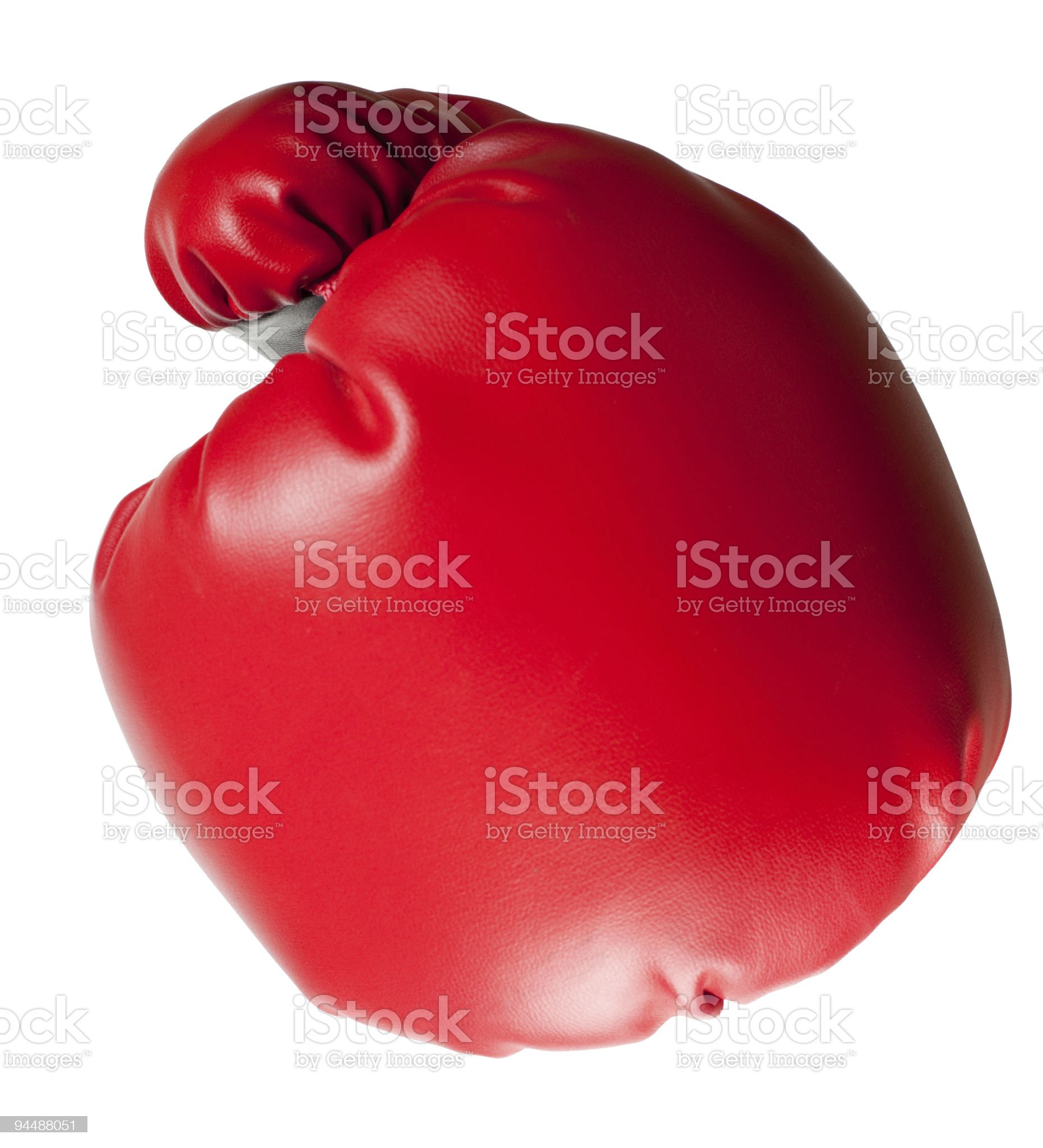 Red boxing glove aimed towards viewer royalty-free stock photo