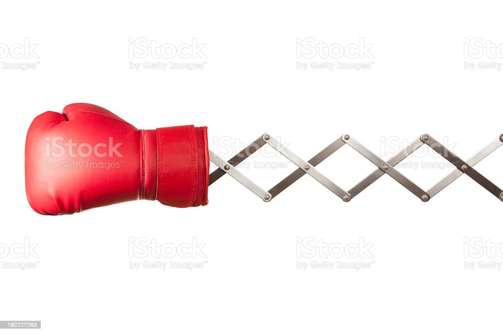 Red boxing glove concertina on white background stock photo