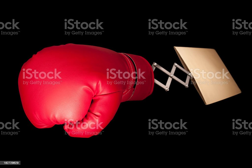 Red boxing glove emerges from manilla envelope royalty-free stock photo