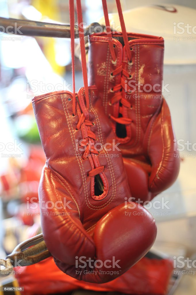 Red boxing gloves hanging above the stage. stock photo