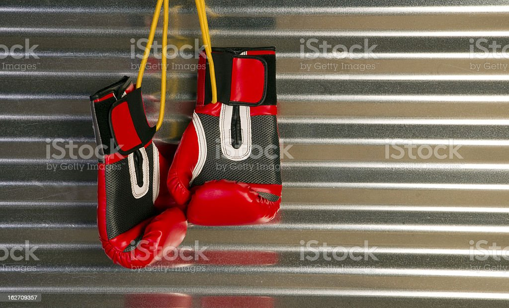 Red Boxing Gloves Hanging on a Hook royalty-free stock photo