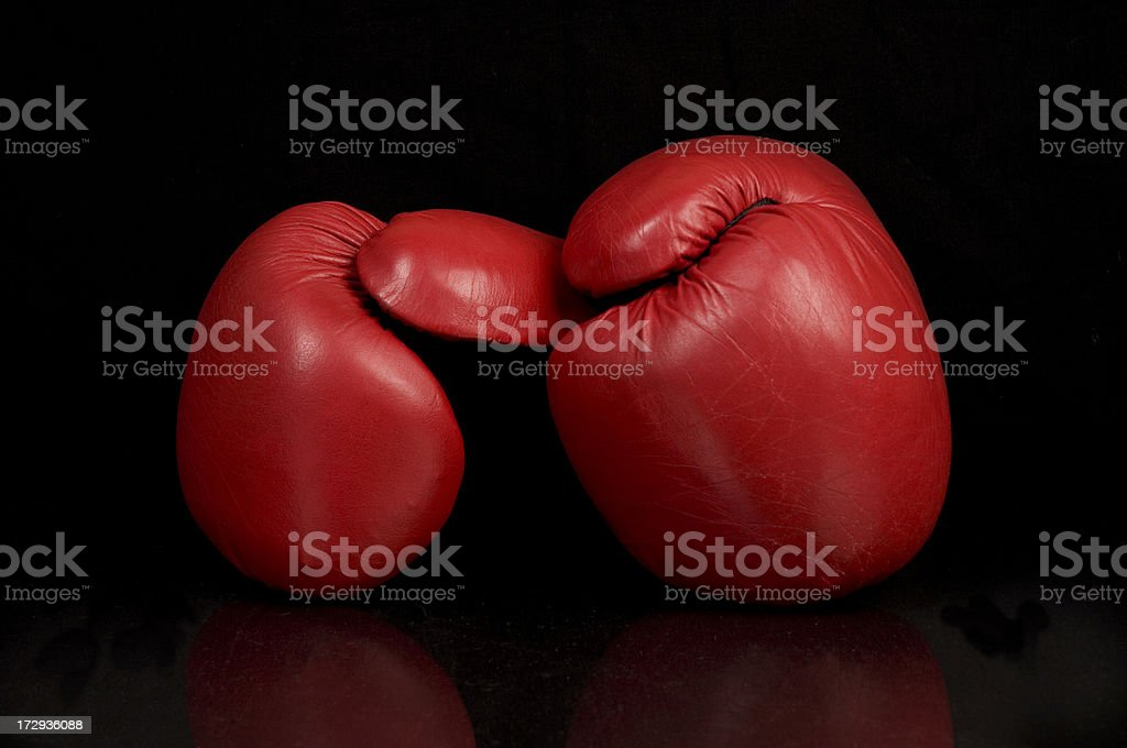 Red Boxing Gloves on Black Background royalty-free stock photo