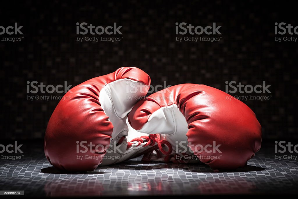 Red boxing gloves on black background stock photo