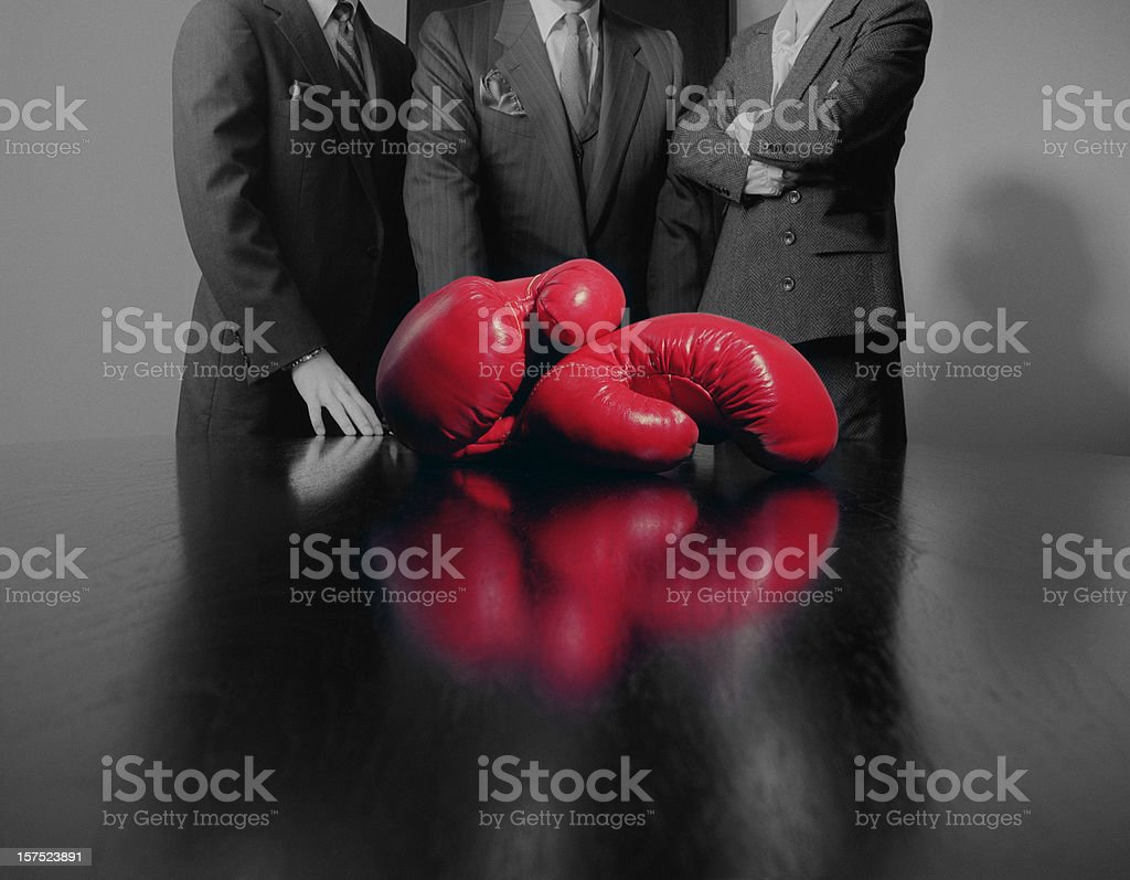 Red Boxing Gloves with Business Persons stock photo