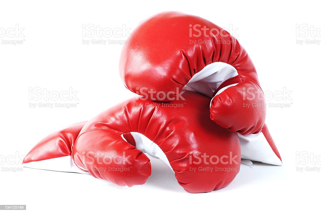 Red boxing leather gloves isolated on white. stock photo