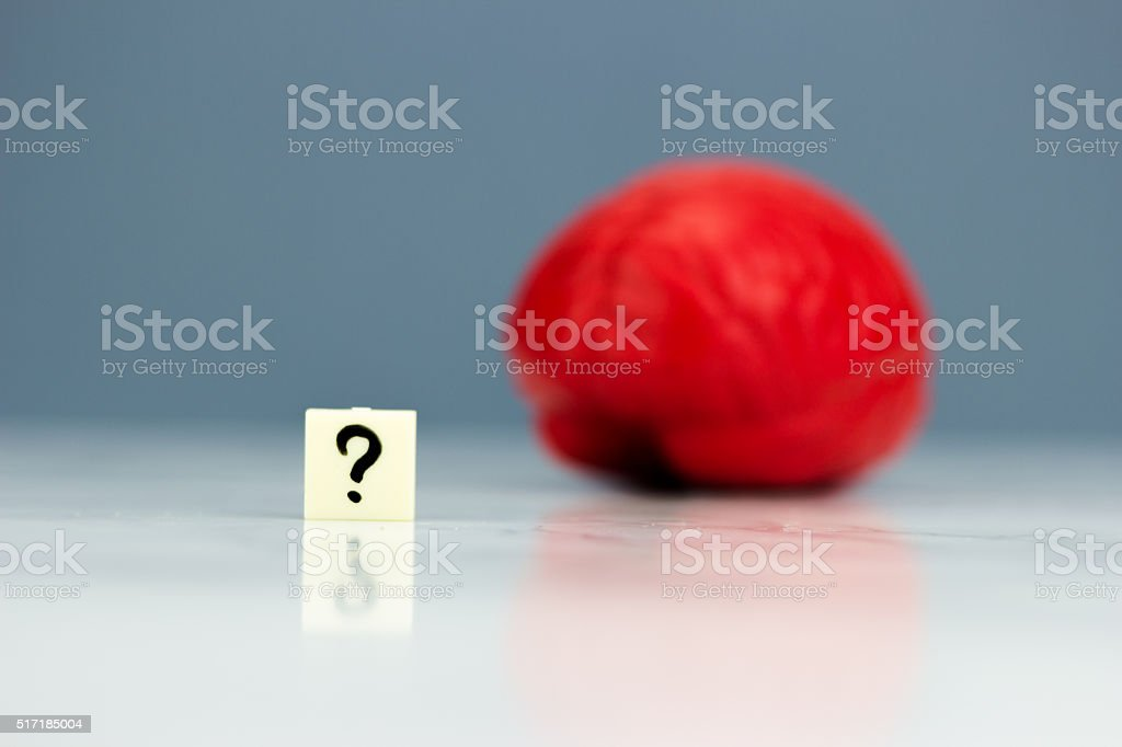 Red brain with question mark stock photo