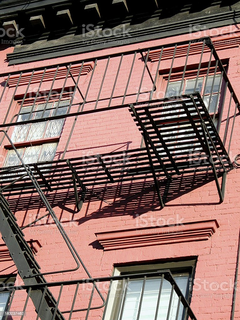 Red Brick Apartment with Fire Escape stock photo
