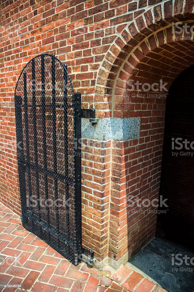 Red Brick Arched Entrance Iron Gate At Fort McHenry Baltimore stock photo