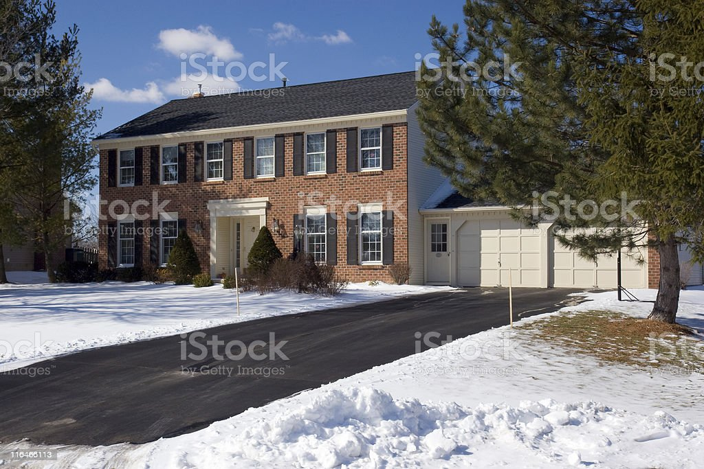 Red Brick Colonial with snow in the winter stock photo