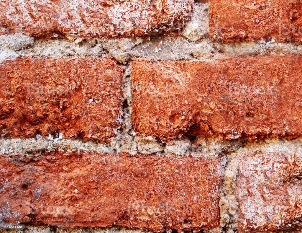 Red brick corroded by corrosion and time. stock photo
