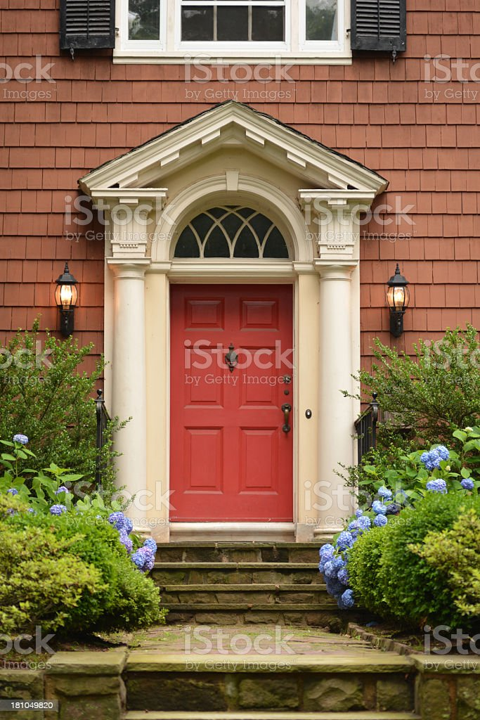 Red brick house with red front door royalty-free stock photo