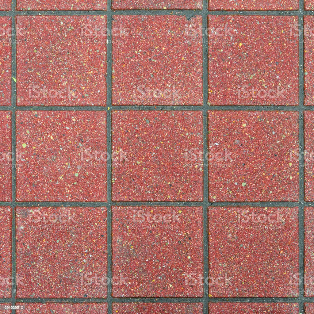 Red brick paving stones on a sidewalk stock photo