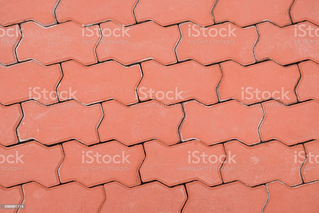 Red brick paving stones on a sidewalk,Floor pattern stock photo