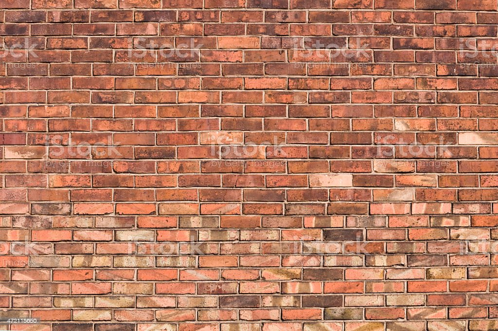 Red brick wall background with varied bricks stock photo