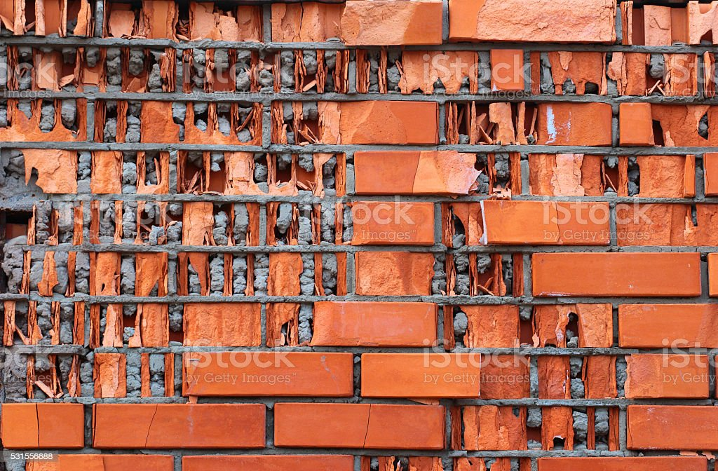 Red brick wall destroyed by frozen water stock photo