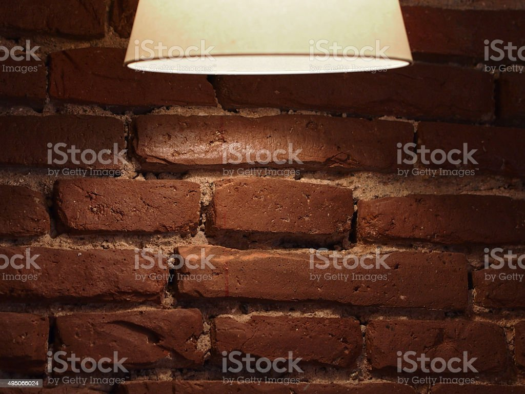 Red brick wall with a lamp stock photo