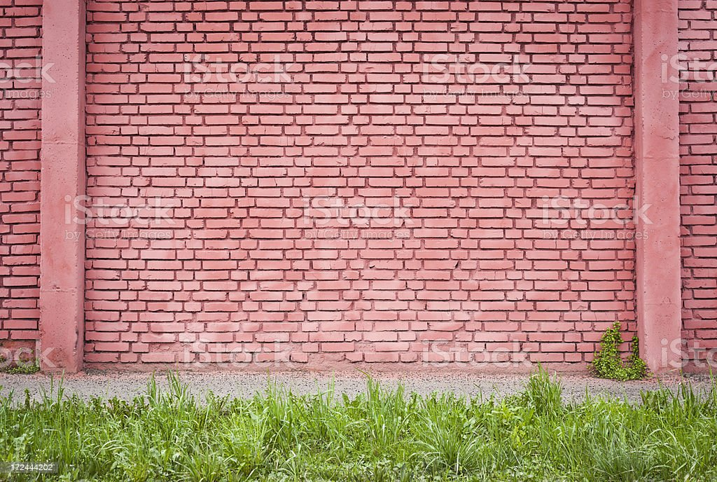 Red Brick Wall With Sidewalk And Grass royalty-free stock photo