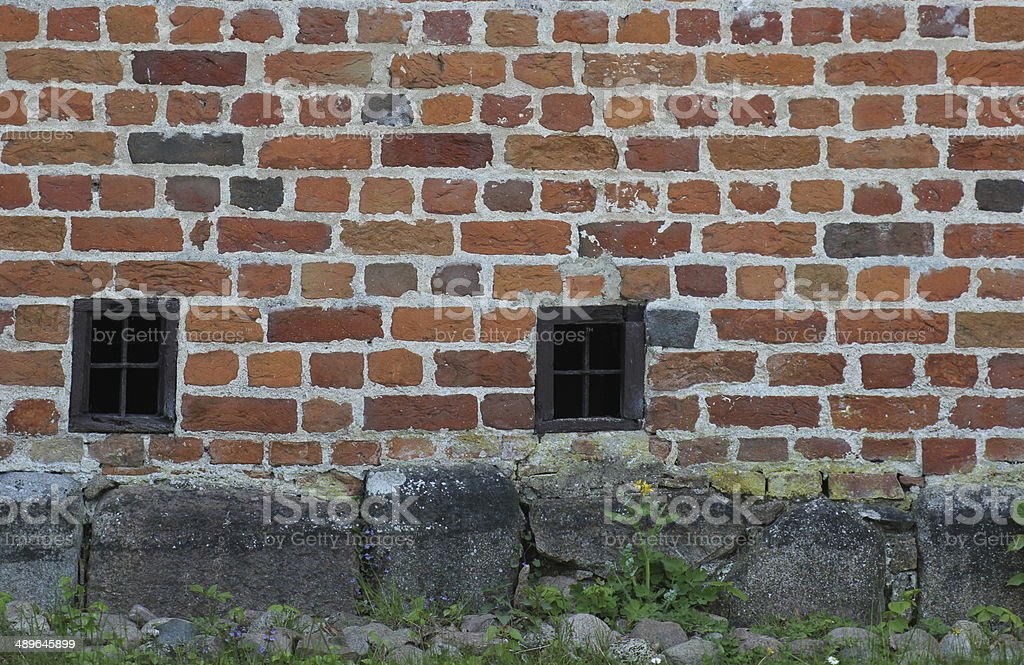Red Brick Wall With Small Windows stock photo