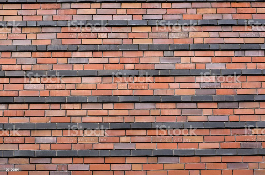 Red brickwall with black stripes stock photo