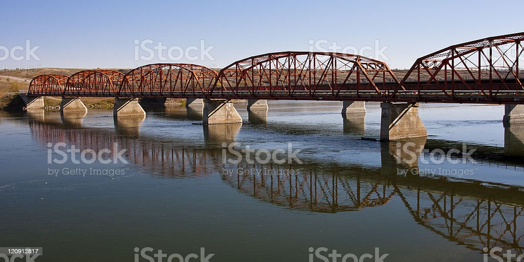 Red Bridge over the Calm River royalty-free stock photo