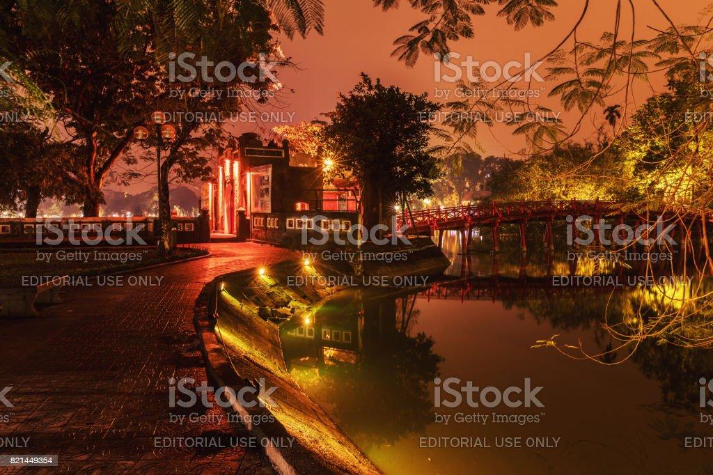 Red Bridge- The Huc Bridge in Hoan Kiem Lake, Hanoi, Vietnam. Night view. This is a lake in the historical center of Hanoi, the capital city of Vietnam stock photo