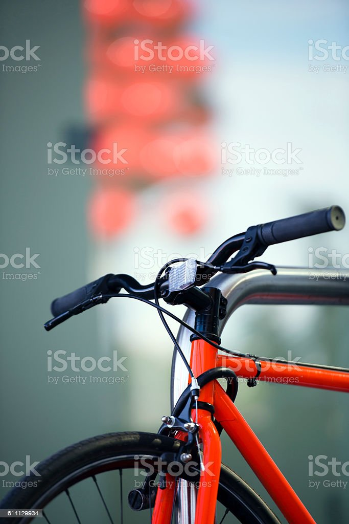 Red bright modern bike with lock on the frame stock photo
