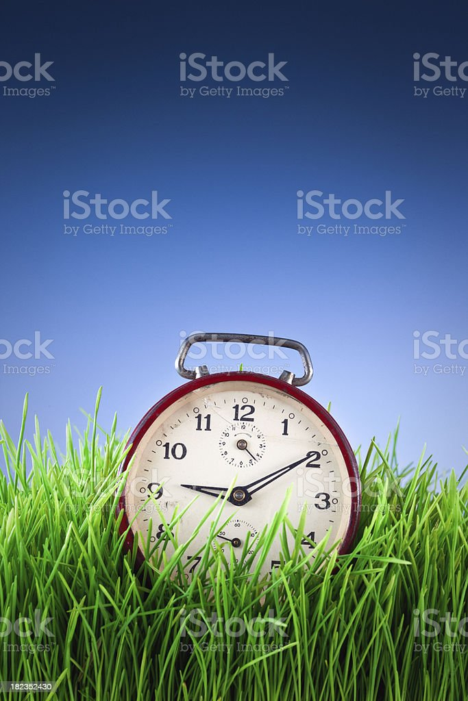 red broken alarm clock royalty-free stock photo