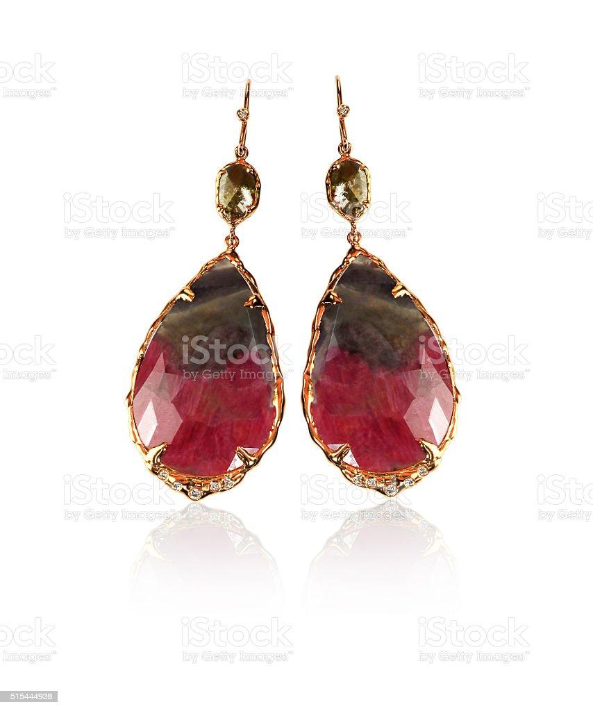 Red brown and green carnelian gemstone earrings stock photo