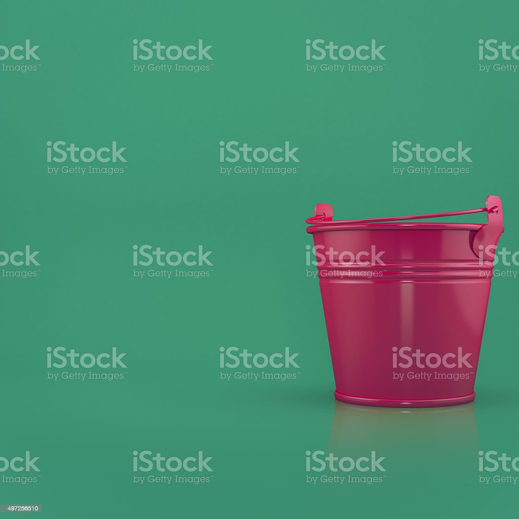 Red bucket on a green background stock photo