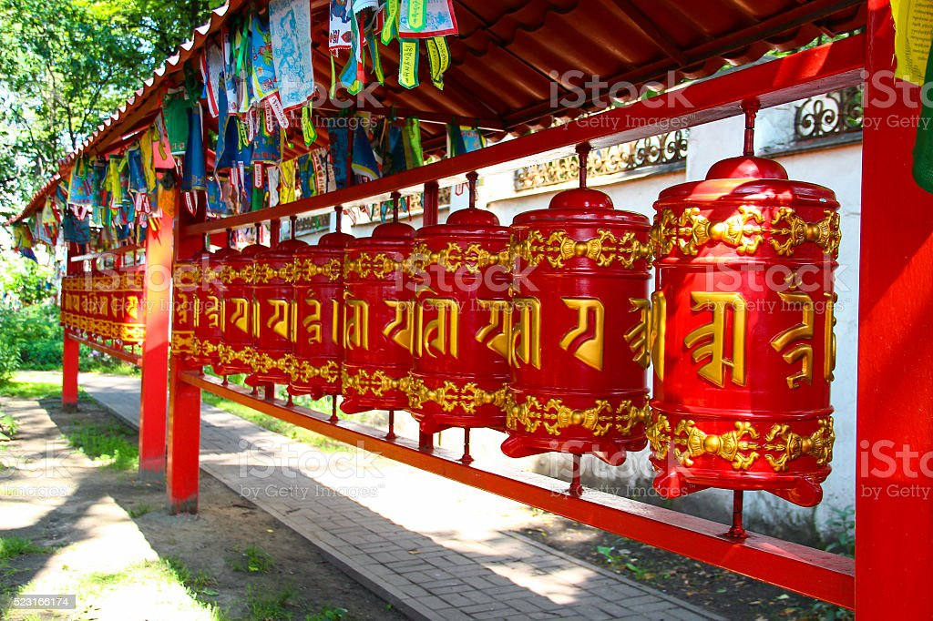 Red buddhist prayer wheels with gold text stock photo