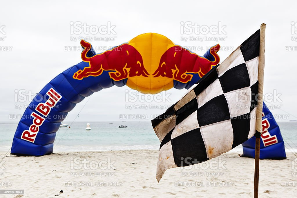 Red Bull arch on beach with chequered flag stock photo