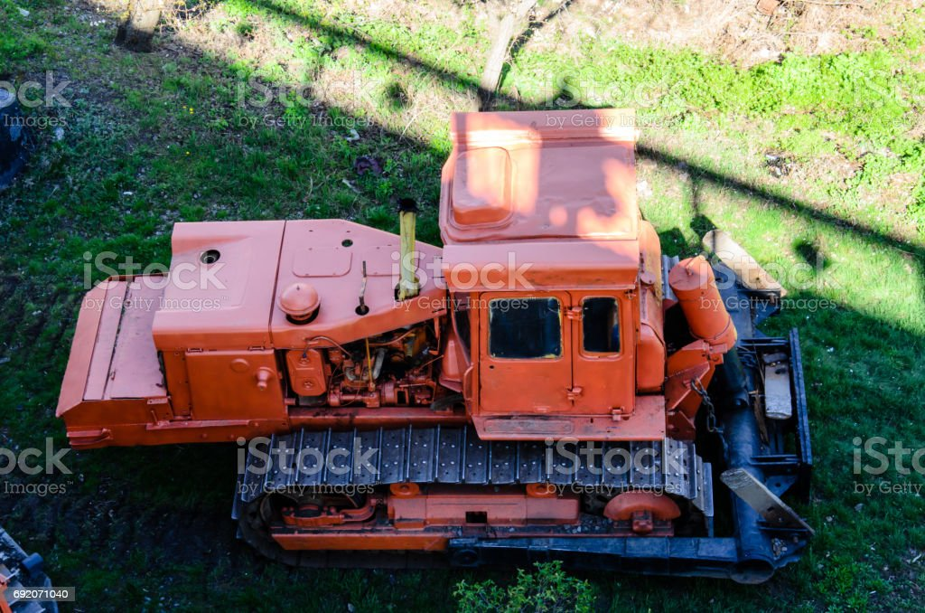 Red bulldozer at a construction site stock photo