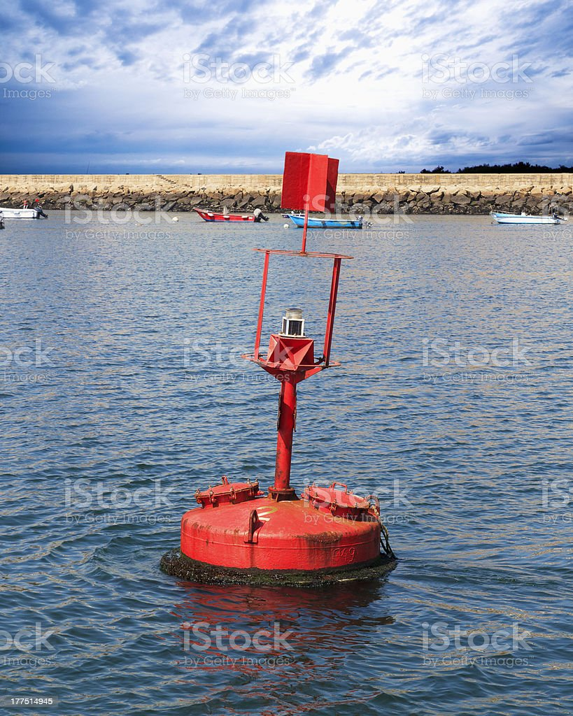 red buoy in the sea royalty-free stock photo