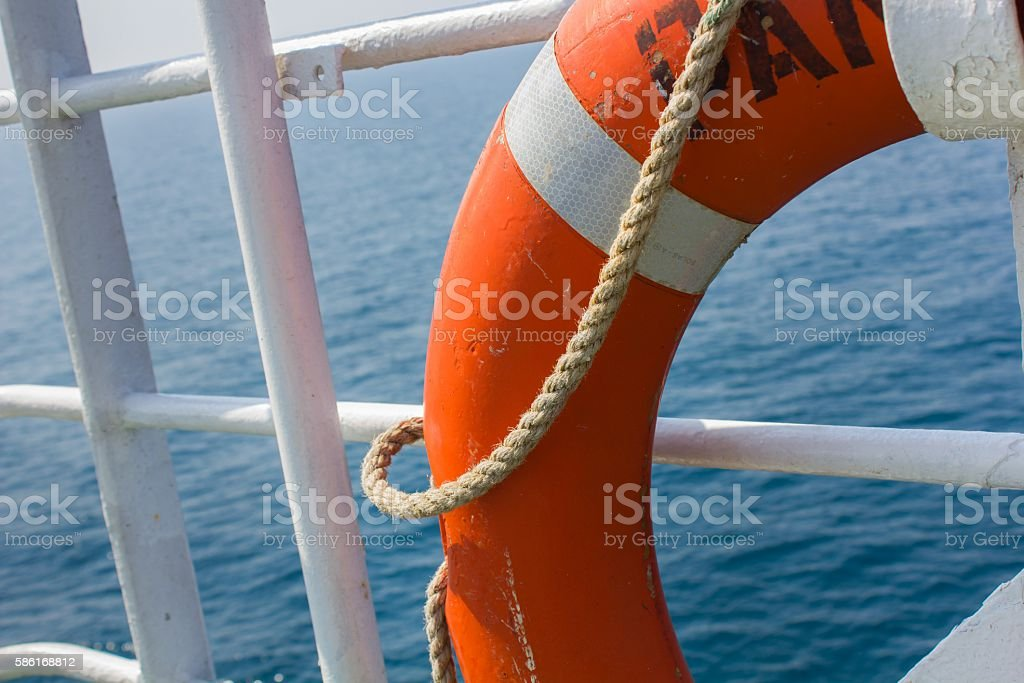 Red buoy on ship stock photo