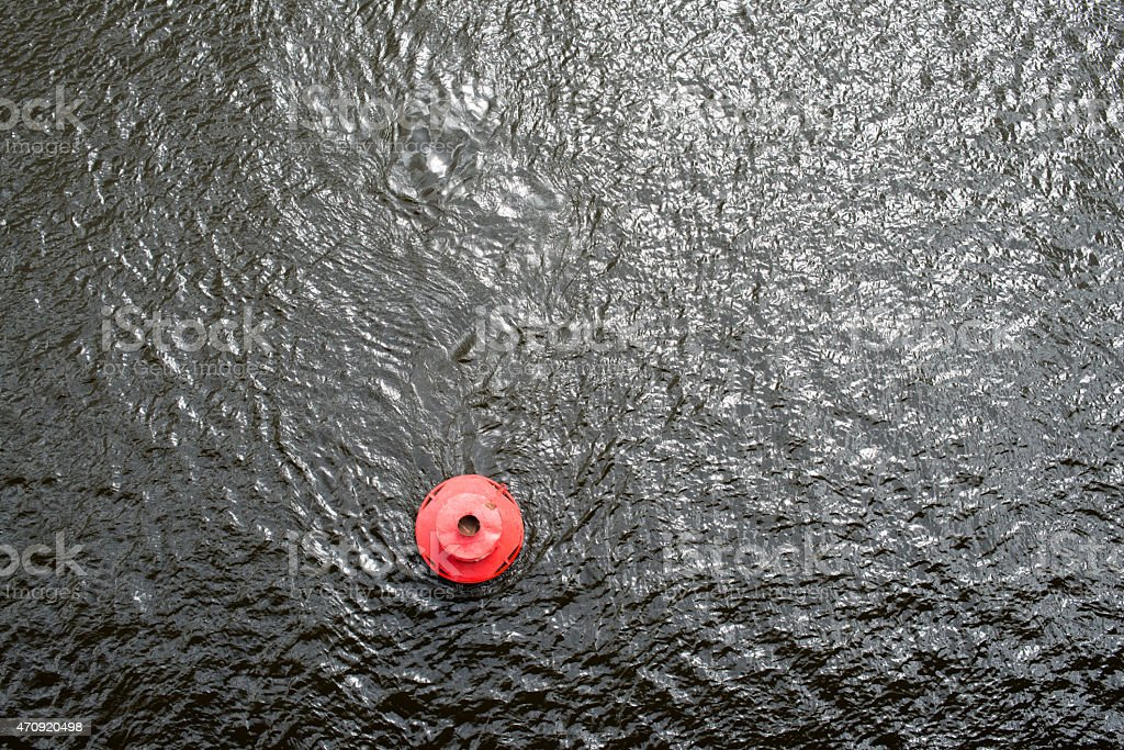 Red buoy on the water surface stock photo