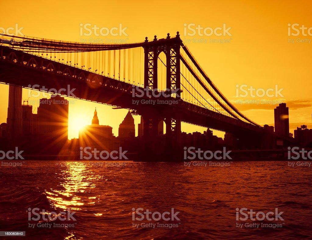 Red burned Brooklyn Bridge in Manhattan - NYC royalty-free stock photo