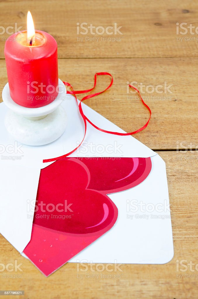 Red burning candle and a Valentine's card royalty-free stock photo