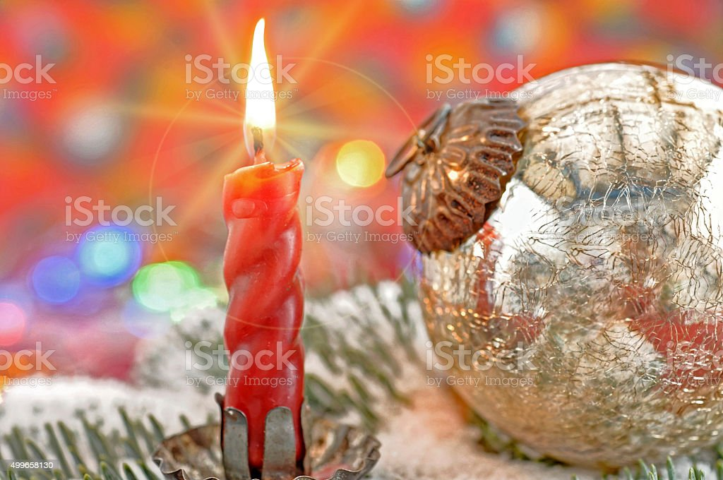 red burning candle and silver Christmas ball stock photo