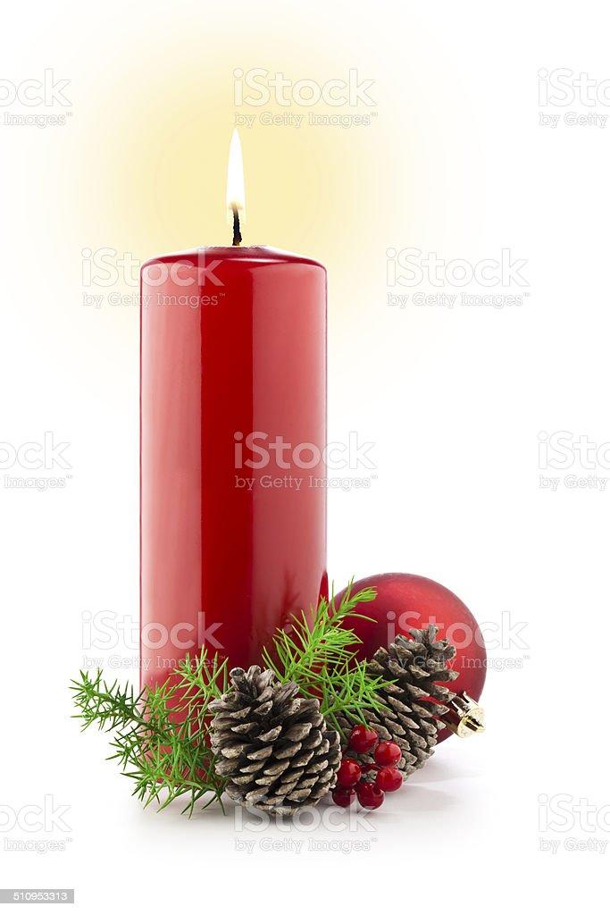 Red burning christmas candle against white backdrop stock photo
