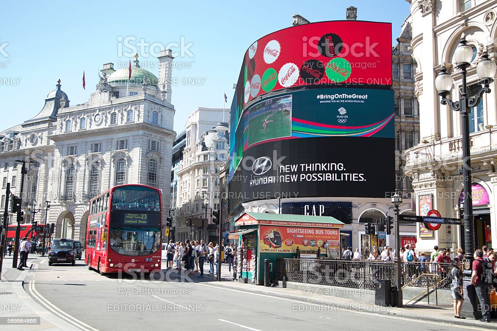 red bus passing busy street in piccally circus stock photo