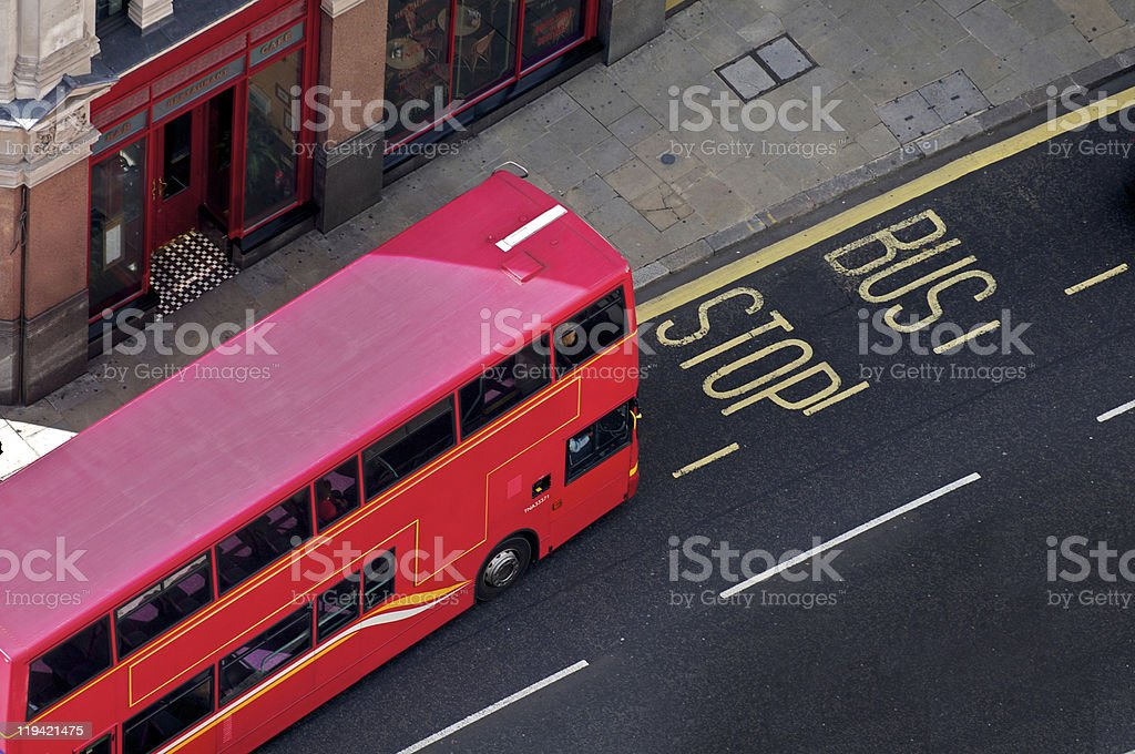 Red bus stopping royalty-free stock photo