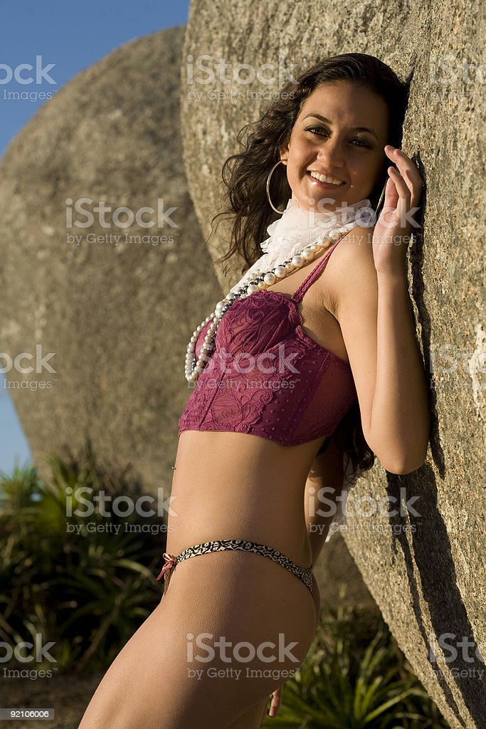 Red bustier by rocks royalty-free stock photo