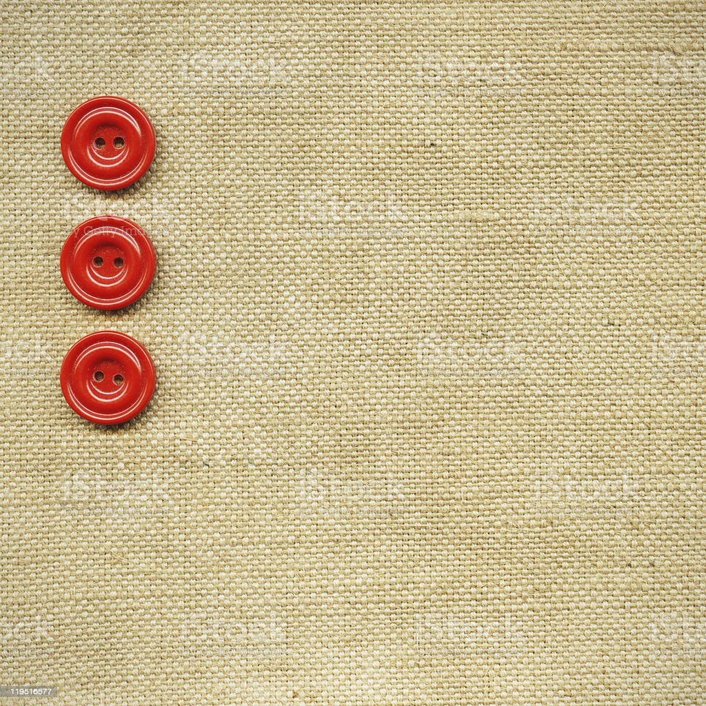 Red buttons on the beige fabric royalty-free stock photo