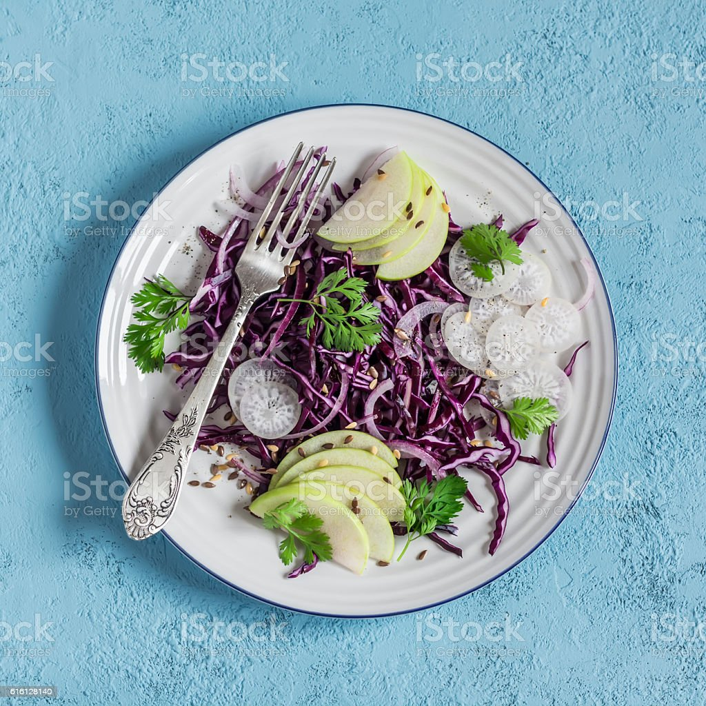 Red cabbage and apple slaw. Vegetarian diet food. stock photo