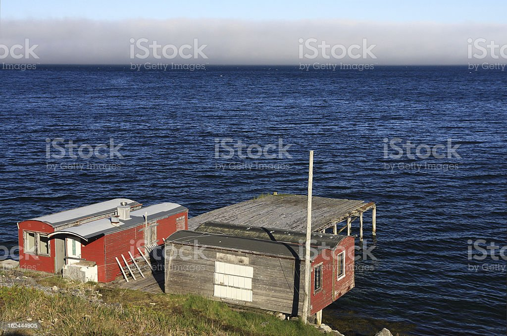 Red cabins on a fjord royalty-free stock photo