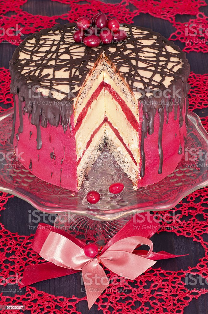 Red cake with poppy seeds, marzipan and chocolate royalty-free stock photo