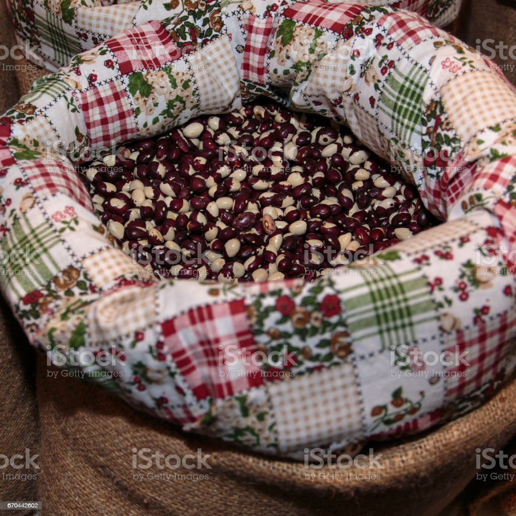 Red Calypso Beans inside Jute Sack for Sale at Market stock photo