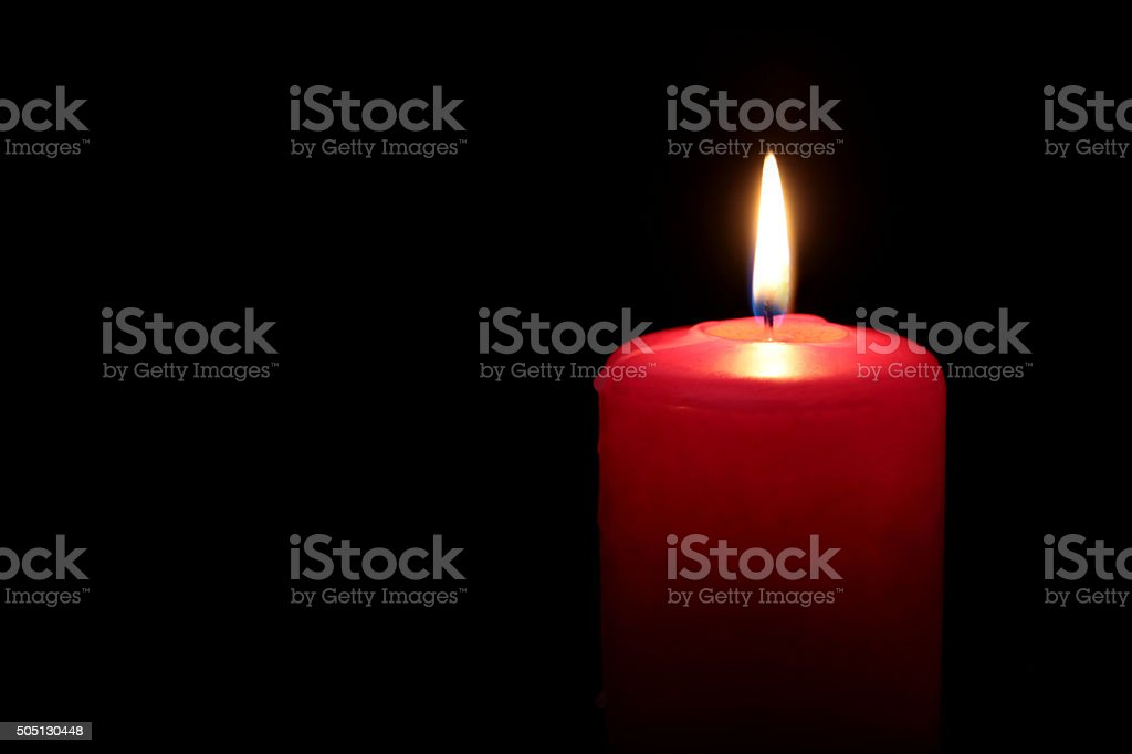 Red candle in dark stock photo