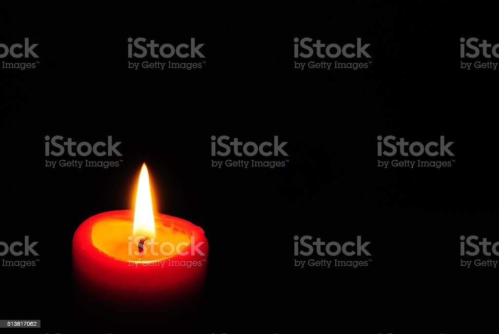 Red candle light with black background stock photo